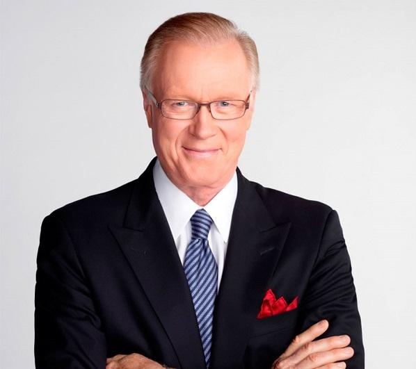 NBC New York anchor Chuck Scarborough poses for a portrait in a suit and tie.