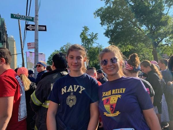Trisha Franckowiak and her daughter Angelina Roffo pose for a photo amid a crowd of people at the annual Tunnel to Towers run.