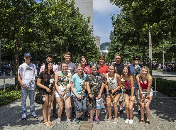 A group of teenagers, all of whom were born on September 11, 2001, pose for a photo on Memorial plaza.