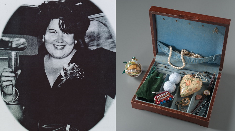 A black and white photo shows Kathleen Moran at her sister's wedding. A wooden jewelry box belonging to Moran is displayed on a gray surface. The box includes Christmas ornaments, pearls and two golf balls, as Moran was a golf enthusiast.