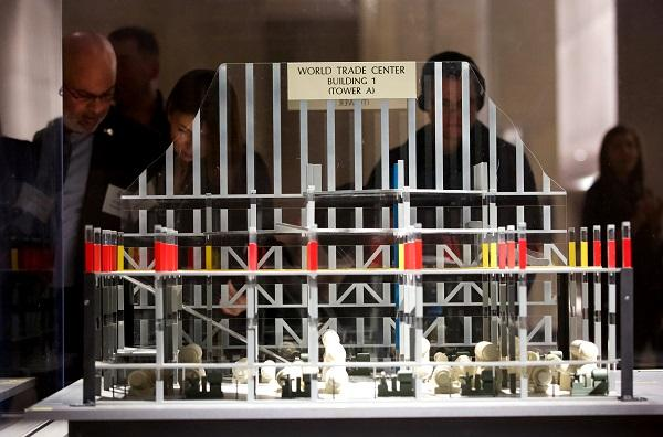 Visitors observe a model of the damaged World Trade Center parking garage in Foundation Hall at the Museum.