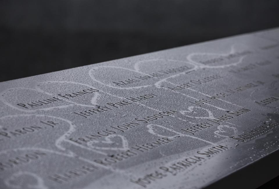 Hearts have been drawn in condensation that formed on names at the 9/11 Memorial.