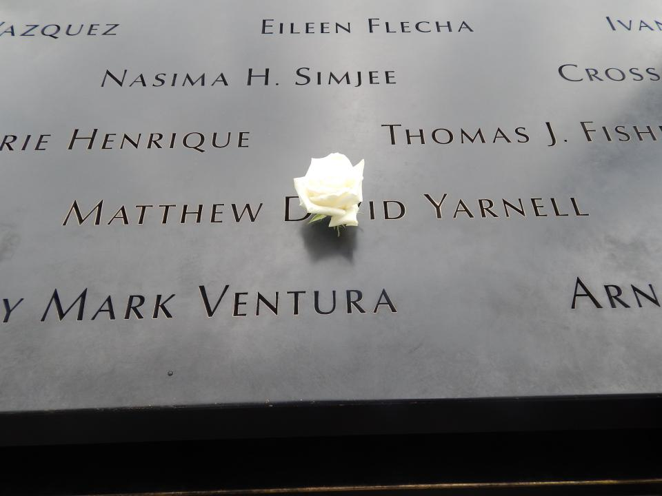 A white rose has been placed at the name of Matthew Yarnell.