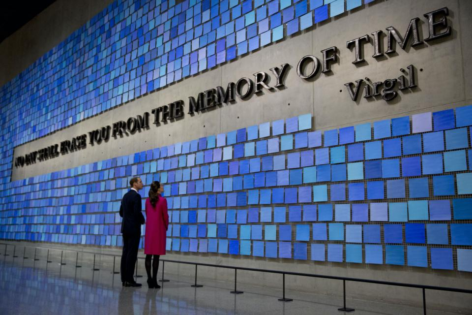 "Prince William, Duke of Cambridge, and Catherine, Duchess of Cambridge, view artist Spencer Finch's work ""Trying to Remember the Color of the Sky on That September Morning"" in Memorial Hall at the Museum. The artwork features the Vigil quote, ""No day shall erase you from the memory of time."" The quote is surrounded by 2,983 squares of Fabriano paper hand-painted different shades of blue."