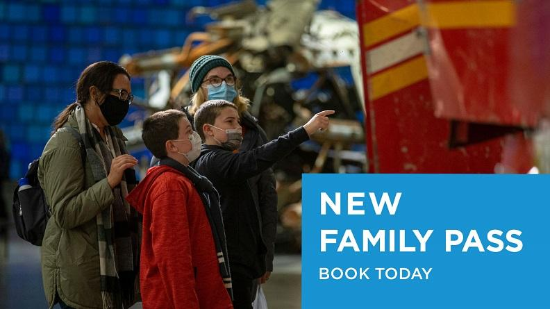 "This photograph features a mask-wearing family with two young children looking at the Ladder 3 firetruck in the Museum. In the bottom right corner, ""New Family Pass, Book Today"" appears in a blue box."