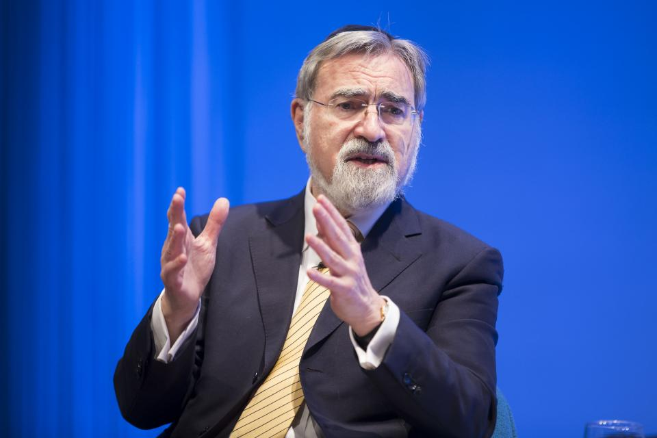Rabbi Jonathan Sacks, who had retired as chief rabbi of the United Hebrew Congregations of the British Commonwealth when he visited the 9/11 Memorial Museum in 2016, raises both his hands as he gestures during a talk about interfaith understanding.