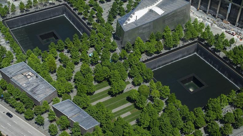 Aerial view of the 9/11 Memorial and Museum on a spring day, with all the oak trees on the plaza in bloom.